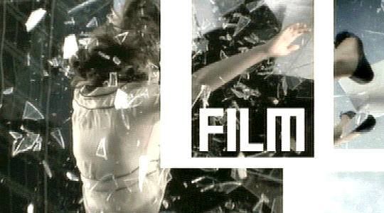 FilmFour promotional advertisement - a girl flying through a pane glass window.
